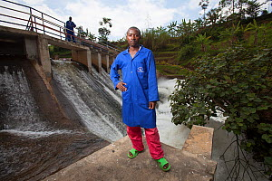 Technicians standing in front of hydro electric power plant, Rwanda, September 2014. - Tom  Gilks