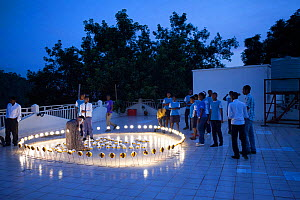 Rwandan students arrange solar lamps on a Kigali rooftop as part of Earth Day 2014, April 2015.  -  Tom  Gilks