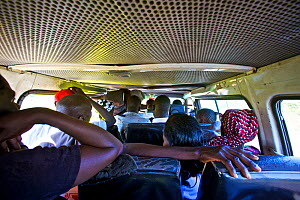 View from the back of a Matatu mini van taxi, Kenya. February 2013. - Tom  Gilks