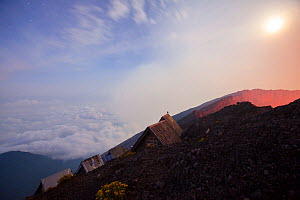 Huts for tourists to sleep in on the edge of Nyiragongo volcano at night, Virungas National Park, Democratic Republic of Congo February 2015.  -  Tom  Gilks