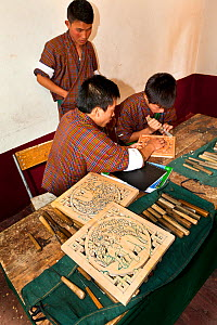 Woodcarving class at the National Institute For Zorig Chusm (School Of The Arts) in Thimphu. Bhutan, October 2014.  -  Kirkendall-Spring