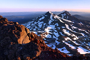 View north at sunrise from the summit of South Sister, Three Sisters Wilderness, Deschutes National Forest. The Large mountains, distance are Middle Sister, North Sister, Mount Jefferson, Mount Hood a... - Kirkendall-Spring