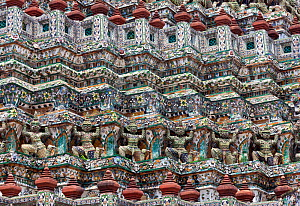 Statues on the walls of Wat Arun, Bangkok, Thailand, September 2014.  -  Kirkendall-Spring
