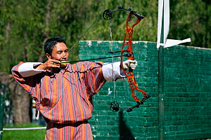 Archery tournament at the Changlimithang Stadium and Archery Ground, Thimphu. Bhutan, October 2014. - Kirkendall-Spring