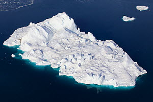 Aerial view of an iceberg in the Ilulissat Icefjord, where the Sermeq Kujalleq Glacier or Jakobshavn Isbrae enters the sea, near Ilulissat, UNESCO World Heritage Site, Kalaallit Nunaat, Greenland. Aug...  -  Michel  Roggo