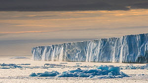 Waterfalls from the enormous glacier front Austfonna, in evening light, Svalbard, Norway, July.  -  Roy Mangersnes