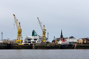 Vessels dry docked for repairs at Cammell Laird, with Birkenhead Priory in the background, Birkenhead, Merseyside, UK, January 2015. - Graham  Brazendale