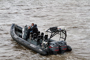 Police RIB on the River Mersey, Liverpool, Merseyside, United Kingdom, July 2014. All non-editorial uses must be cleared individually. - Graham  Brazendale