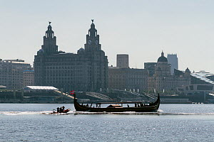 Draken Harald Harfagre (Dragon Harald Fairhair), passing by the Three Graces, Royal Liver buildings, Cunard and Port of Liverpool buildings. This is the largest Viking ship built in modern times, arri...  -  Graham  Brazendale