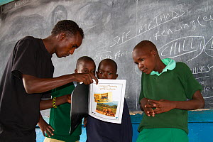 Save the Elephants mobile eduction unit teaching children about living together with elephants and how to protect them. GirGir Primary School, near Samburu National Reserve, Kenya. - Lisa  Hoffner