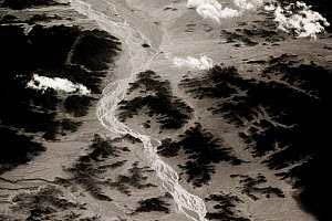 View from plane of rivers flowing through mountain valley, Saravan, South East Iran, December.  -  Paul Williams