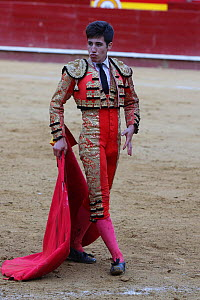Bull fighter / torero in traditional costume with cape, Plaza de Toros, Valencia, Spain. July 2014. - Barry Bland