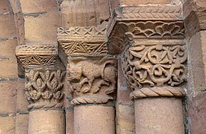 Stone carved motifs of a lion and sheaves of corn of the west doorway of Leominster Priory, Herefordshire School of Romanesque Sculpture, dating from the 12th Century, Herefordshire,  England.  -  Will Watson