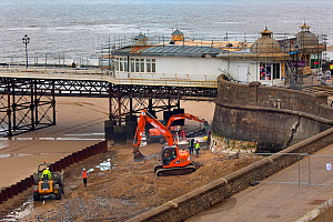 Repairs to Cromer sea wall after the tidal surge in December 2013, Norfolk, England, UK. January 2015.  -  Ernie  Janes