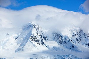 Snow covered mountains, Port Lockroy, Antarctica, January.  -  Michael Hutchinson
