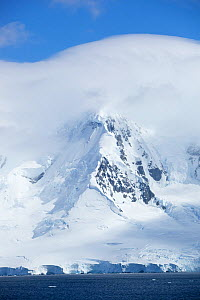 Snow covered mountain, Port Lockroy, Antarctica, January.  -  Michael Hutchinson