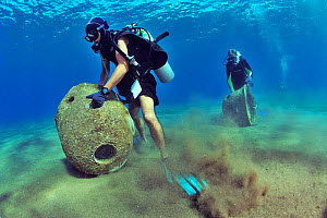 Divers are setting up concrete reef balls to build an artificial reef, Philippines, Sulu Sea. August 2014.  -  Pascal Kobeh