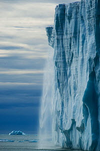 Ice cliff of the Austfonna ice cap with melt water and ice crashing down to the sea, Svalbard, Norway, July 2012.  -  Ole  Jorgen Liodden
