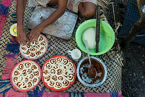 Man from Ligau Levu Village preparing roly poly bread with sweetend grated coconut for breakfast, Mali Island, Macuata Province, Fiji, South Pacific. August 2013  -  Jurgen Freund