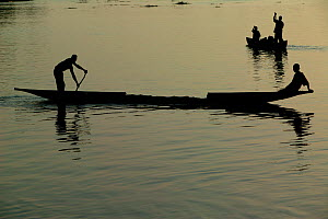 Men on pirogue on the Congo River, Mbandaka, Democratic Republic of the Congo.  -  Cyril Ruoso