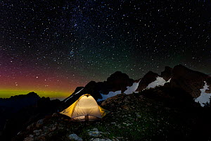Campsite at night, with light pollution from nearby city, below Three Fingers Lookout, Boulder River Wilderness, Mount Baker, Washington, USA. August 2014.  -  Kirkendall-Spring