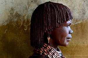 Profile portrait of Hamer woman with traditional ornaments and braided hair covered in ochre and butter, Territory of the hamer tribe. Lower Omo Valley. Ethiopia, November 2014 - Enrique Lopez-Tapia