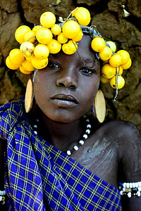 Mursi girl with her traditional headdress of fruit, Mursi tribe. Mago National Park. Ethiopia, November 2014  -  Enrique Lopez-Tapia