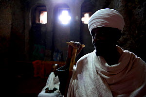 Christian worsphiper at Bet Medhane Alem Complex (part of the northwestern group of churches in Lalibela). UNESCO World Heritage Site. Lalibela. Ethiopia, December 2014.  -  Enrique Lopez-Tapia