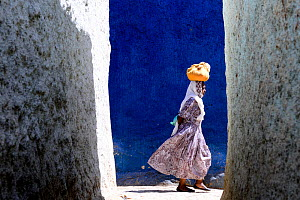 Women walking through the colourful narrow streets of Harar, an important holy city in the Islamic faith, UNESCO World Heritage Site. Ethiopia, November 2014  -  Enrique Lopez-Tapia
