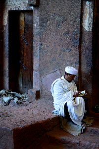 Priest reading bible in Bet Meskel church (part of the northwestern group of churches in Lalibela). UNESCO World Heritage Site. Lalibela. Ethiopia, December 2014. - Enrique Lopez-Tapia