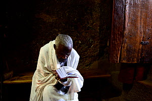 Priest reading Bible in Bet Maryam church (part of the northwestern group of churches in Lalibela). UNESCO World Heritage Site. Lalibela. Ethiopia, December 2014.  -  Enrique Lopez-Tapia