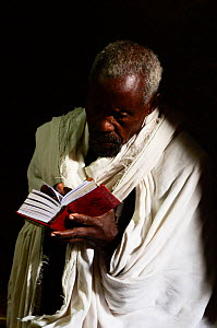 Priest reading Bible in Bet Maryaml church (part of the northwestern group of churches in Lalibela). UNESCO World Heritage Site. Lalibela. Ethiopia, December 2014.  -  Enrique Lopez-Tapia