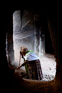Christian woman praying, Bet Danaghel (part of the northwestern group of churches in Lalibela). UNESCO World Heritage Site. Lalibela. Ethiopia, December 2014. - Enrique Lopez-Tapia