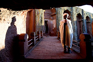 Priest holding a cross at Bet Gabriel-Rufael Church, Lalibela. UNESCO World Heritage Site. Ethiopia, December 2014.  -  Enrique Lopez-Tapia