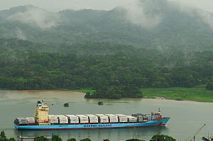 Container ship sailing through the Panama Canal. All non-editorial uses must be cleared individually.  -  Enrique Lopez-Tapia