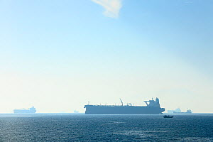 Oil tankers in the Gulf of Oman, seen from the Ferry Musandam to Shinas (Oman), United Arab Emirates. All non-editorial uses must be cleared individually. - Oriol  Alamany