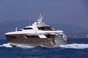 Super yacht leaving Cannes Marina, France. All non-editorial uses must be cleared individually.  -  Philip  Stephen