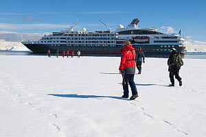 Passengers from 'L�Austral' walking on the winter fast ice in Wilhelmina Bay, Antarctic Peninsula, December 2012. All non-editorial uses must be cleared individually. - Rick Price