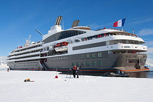 'L�Austral' alongside the winter fast ice in Wilhelmina Bay, Antarctic Peninsula, December 2012. 200 passenger French owned vessel, sister ship to 'Le Boreal'. All non-editorial uses must be cleared i... - Rick Price