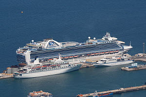 Crown Princess (largest) with Discovery and the Clipper Odyssey (smallest, a 120 passenger vessel) in Gibraltar Harbour, May 2012. All non-editorial uses must be cleared individually. - Rick Price