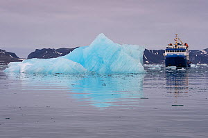 MS Quest passing iceberg, Bj�rnfjorden, Svalbard, Norway, September 2014. All non-editorial uses must be cleared individually. - Staffan Widstrand