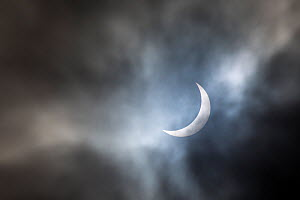 Solar eclipse with partial cloud cover, Peak District, Derbyshire, UK. 20th March 2015.  -  Alex  Hyde