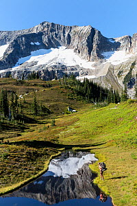 Vicky Spring next to a small tarn, Lyman Lakes Basin, Glacier Peak Wilderness, Wenatchee National Forest, Washington, USA, September 2014. Model released. - Kirkendall-Spring Photographers