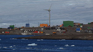 Wind turbine turning, Mawson Station, Antarctica. - Fred  Olivier