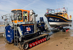 Lifeboat towed to station with tractor and trailer. Hoylake, Wirral, Merseyside, England UK. March 2015 All non editorial uses must be cleared individually. - Norma  Brazendale