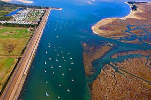 Aerial view of  boats in East Fleet, with Pinewoods caravan park, and salt marshes on the coast of Norfolk, England, UK, February 2009. - Ernie  Janes