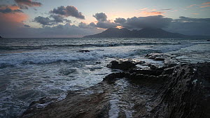 Waves breaking on the shore at sunset, looking towards Rum, Isle of Eigg, Inner Hebrides, Scotland, UK, April 2013. - SCOTLAND: The Big Picture