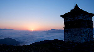 Sunrise from a mountain summit, with a Buddhist monastery in the foreground, Himalayas, Bhutan, May 2015. - Sandesh  Kadur