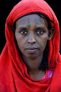 Head portrait of Afar tribe woman with facial tattoos / skin scarifications and wearing a head scarf, Malab-Dei village, Danakil depression, Afar region, Ethiopia, March 2015. - Eric Baccega