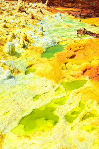 Dallol hot spring with salt concretions coloured by sulphur, potassium and iron, Dallol Volcano, Danakil Depression, Ethiopia, March 2015. - Eric Baccega